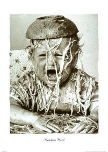 Crying child with a bowl of spaghetti on it's head.